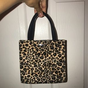 Cute and small leopard print Nine West purse.